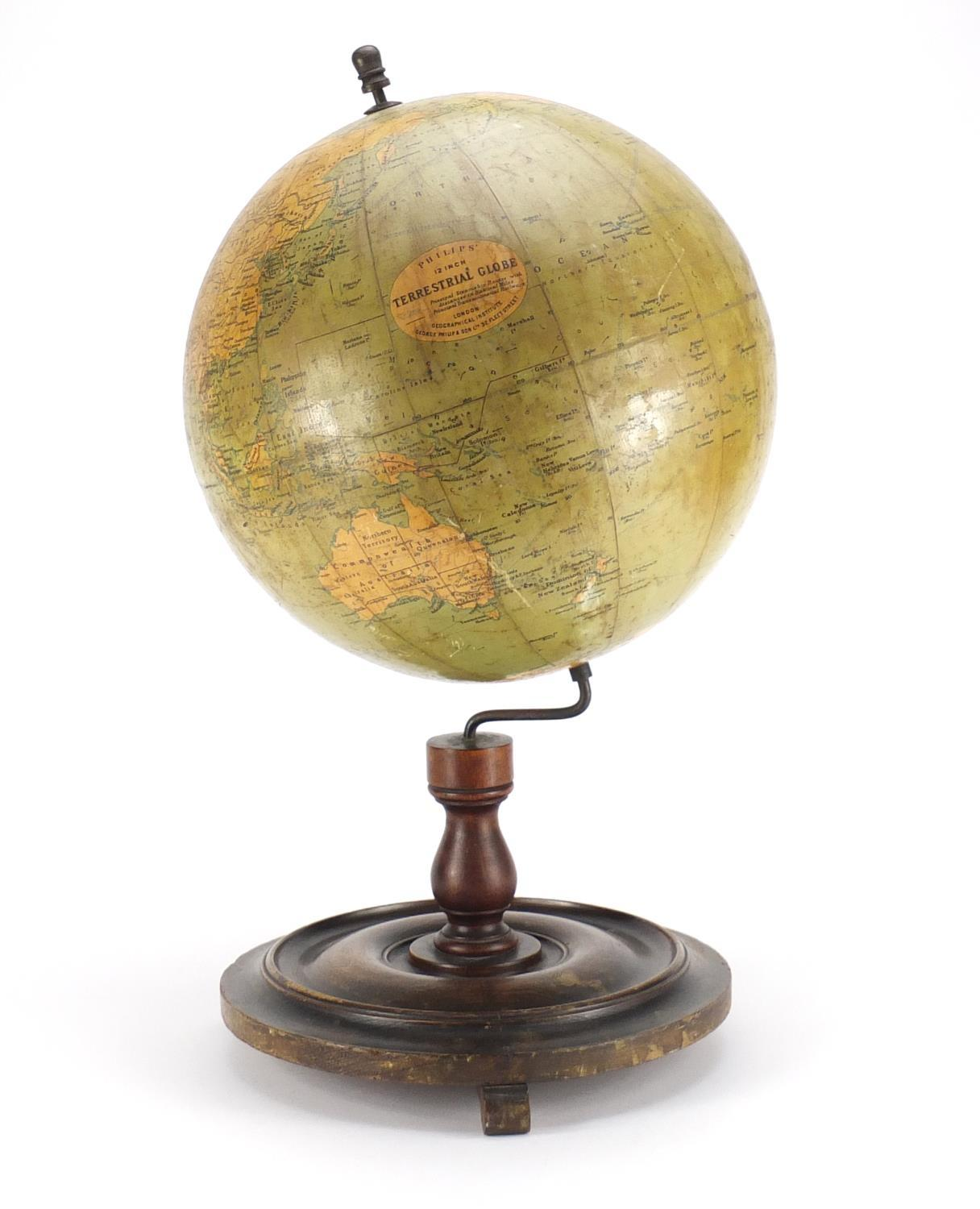 Lot 25 - Philips 12inch terrestrial globe raised on a stained mahogany base, 52cm high :For Further Condition