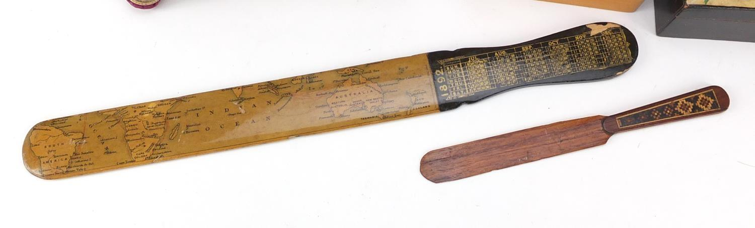 Lot 38 - Woodenware and reference books including Mauchline Ware pin cushion, Tunbridge Ware letter opener