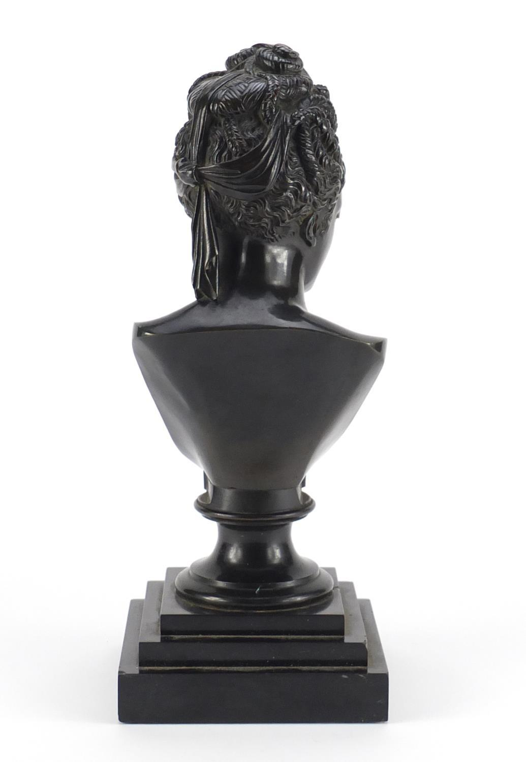 Lot 7 - 19th century classical patinated bronze bust of a nude female, raised on a square stepped black