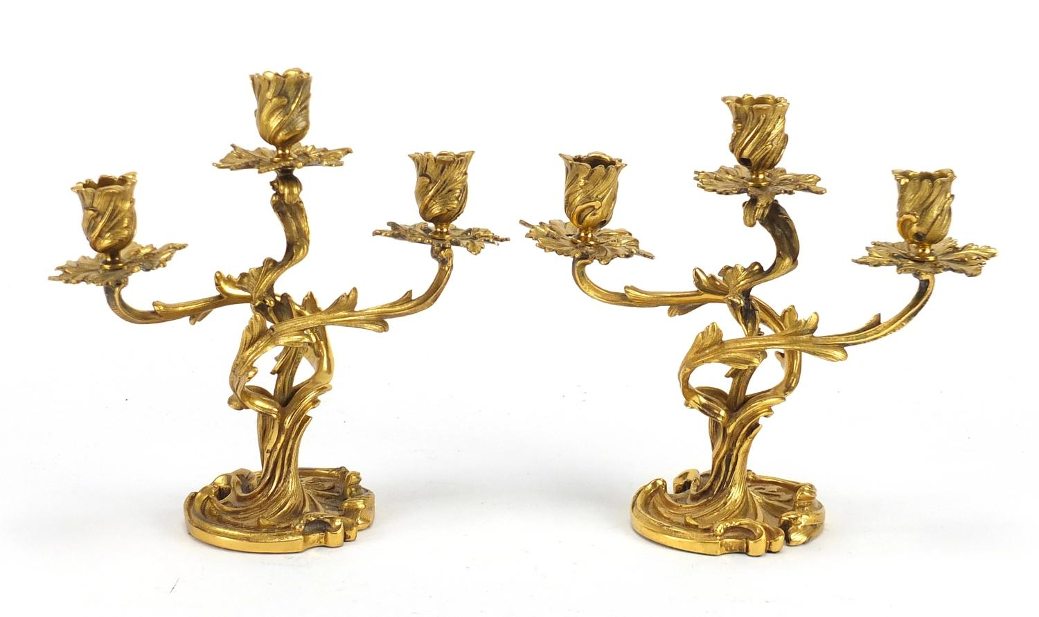 Lot 15 - Pair of 19th century French Louis XV ormolu three branch candelabras, each 25cm high :For Further