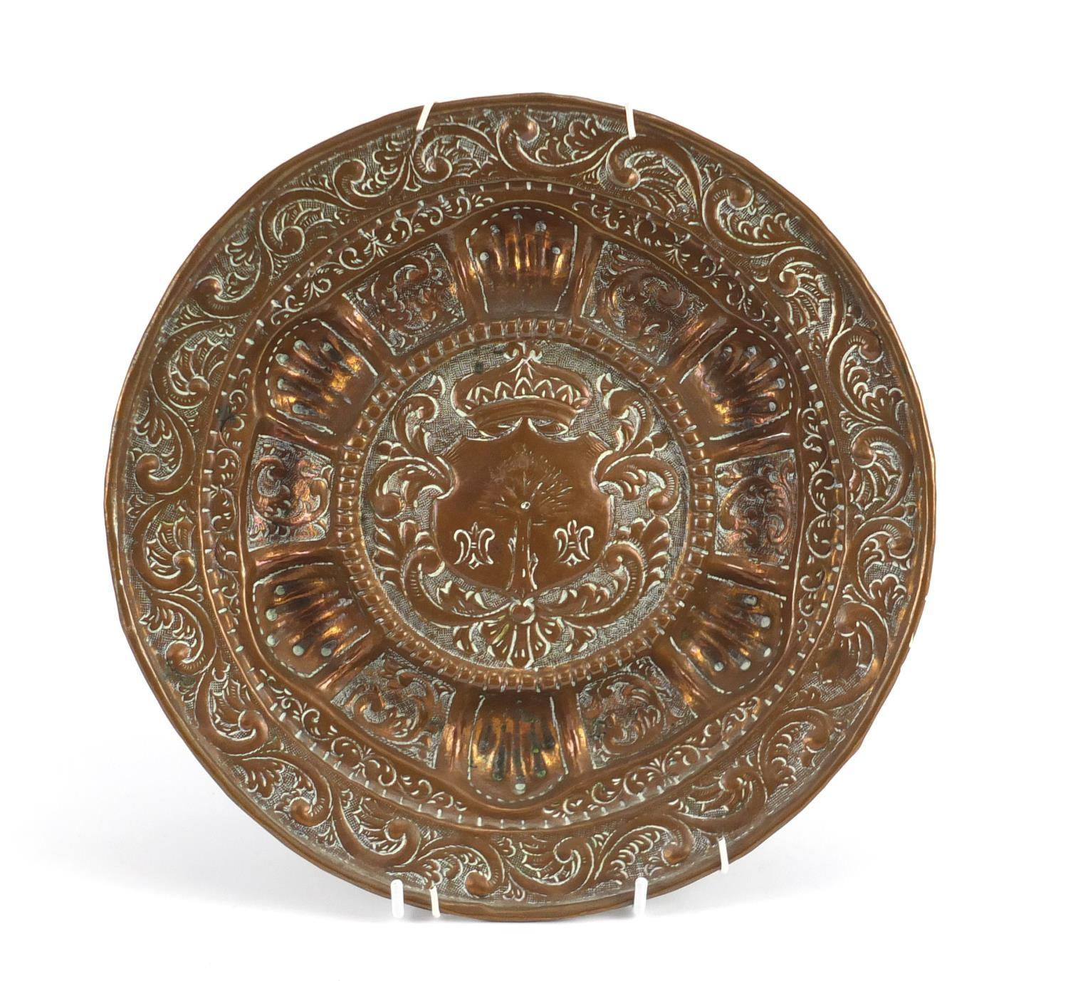 Lot 22 - Antique copper plate embossed with a heraldic crest, 27.5cm in diameter :For Further Condition