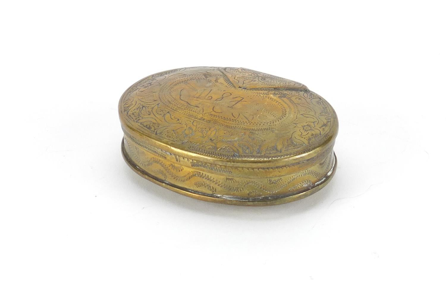 Lot 48 - Antique Dutch oval brass tobacco box, engraved with flowers, dated 1687, 8.5cm wide :For Further