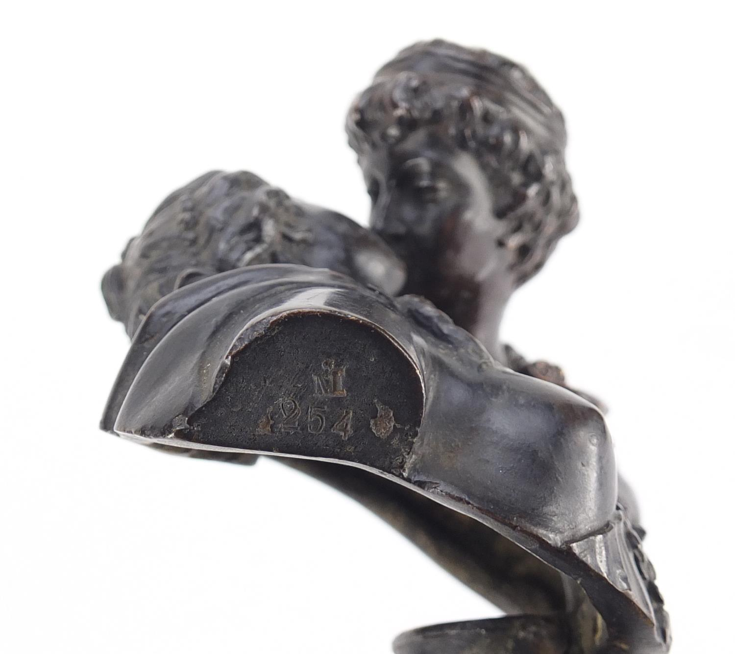 Lot 8 - 19th century classical patinated bronze of lovers kissing, raised on circular ebonised base, the