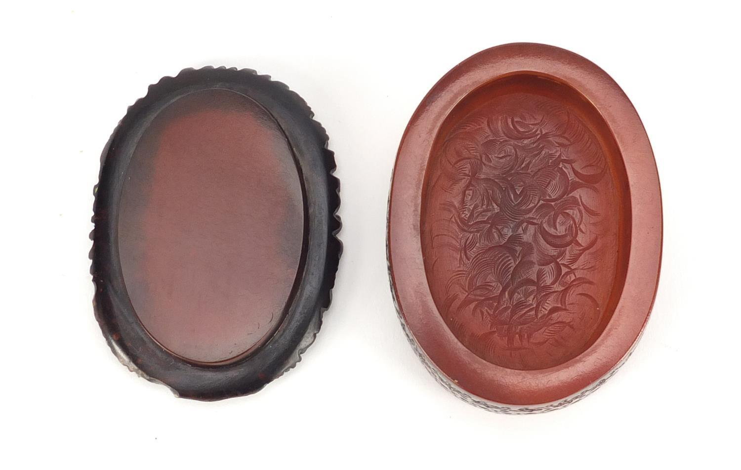 Lot 50 - French pressed snuff box, the lift off lid decorated with a female holding a bird, signed to the