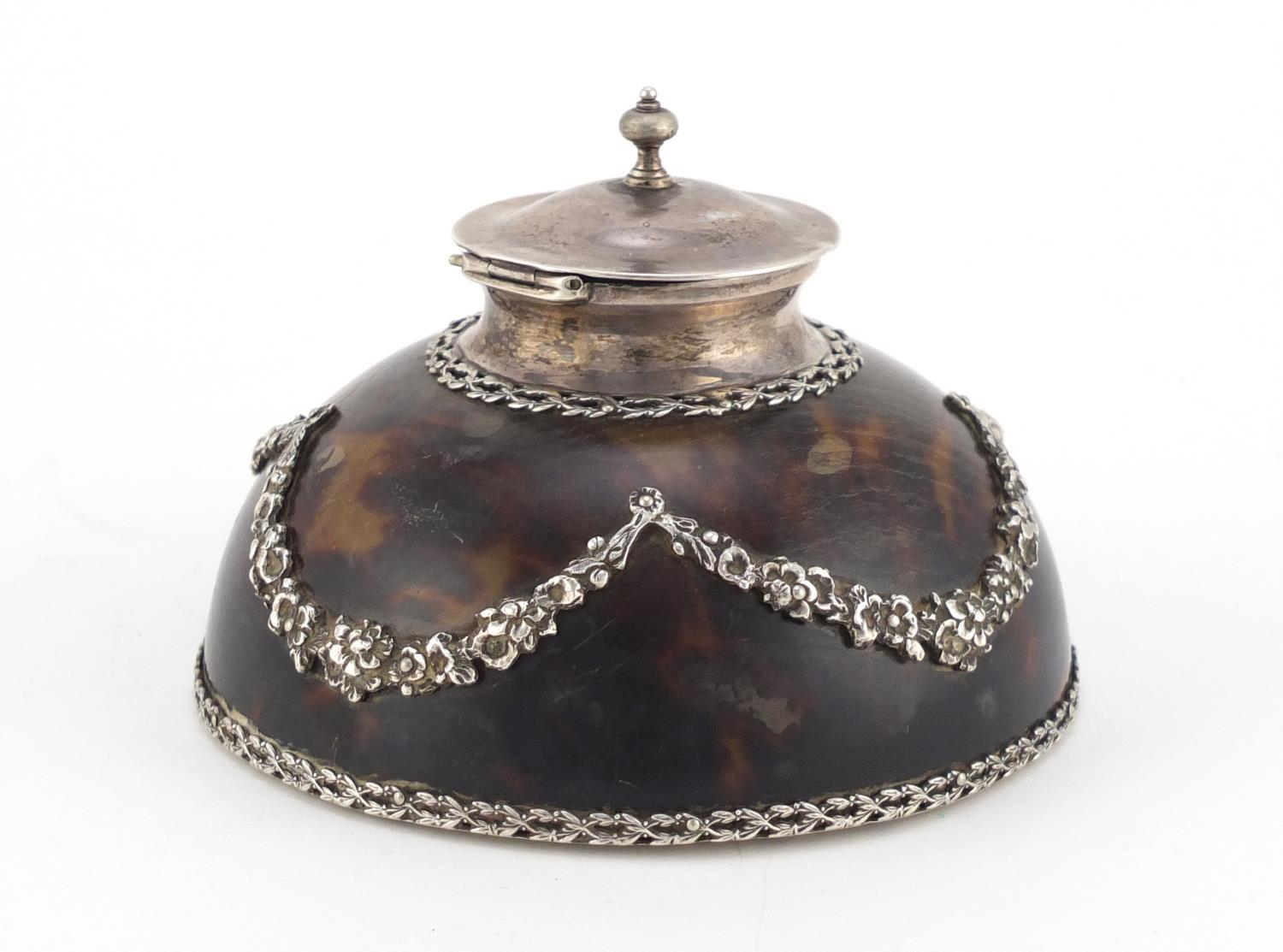 Lot 54 - Edwardian tortoiseshell and cut glass inkwell with silver mounts by Apsrey & Co, decorated in relief