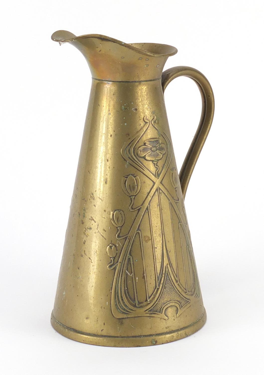 Lot 200 - Art Nouveau brass flagon embossed with stylised flowers, impressed J S & S to the base, 29cm