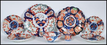 A collection of 20th Century Japanese Imari ceramics to include two wall charger plates having