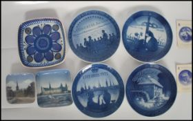 A group of four Royal Copenhagen blue and white porcelain plates to include a Bicentenary 1775-1975,