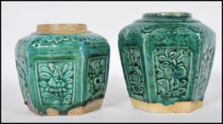 A pair of late 19th Century Chinese stoneware ginger jars of hexagonal form having panels of