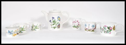 A small collection of Portmeirion Evesham ware ceramics to include teapot, creamers, lidded sugar