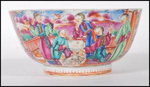 A late 19th Century Chinese bowl having hand painted and enamel figures in a courtyard scenes and