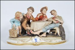 A large Capodimonte figure group signed by Merli, 'The Card Cheat', featuring four card players