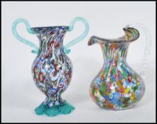 Two 20th Century Murano glass vases both having coloured millefiori designs to include a waisted