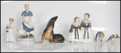 A collection of Royal Copenhagen figurines to include no. 1316 figure group of two milk maids, no.