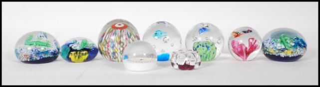 A collection of eight 20th Century glass studio paperweights to include an example by Murano