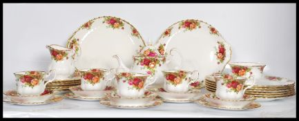 A Royal Albert bone China dinner / tea service in the Country Roses pattern. Consisting of dinner