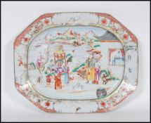 A 18th Century circa 1780 QingDynasty famille rose serving platter plate depicting a court yared