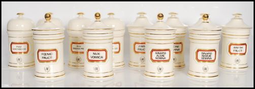 A group of twelve 20th Century Chalsyn Ltd ceramic apothecary jars and covers all having white