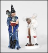 Two Royal Doulton bone China figurines to include The Wizard HN 2877 and The Wig Maker of