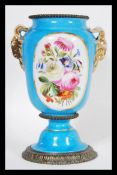 A 19th Century French ceramic urn vase in the manner of Sevres having a powder blue ground with