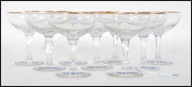 SET OF NINE 1950'S BABYCHAM ADVERTISING GLASSES