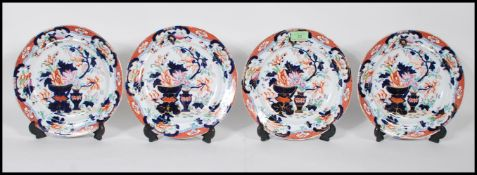 A group of four 19th Century Georgian Staffordshire Tonquin Oriental style ironstone plates having
