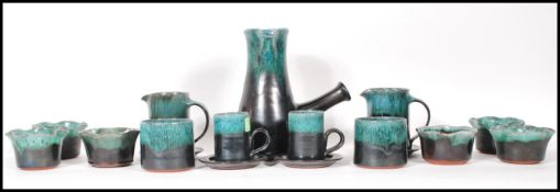 A vintage Woburn studio pottery coffee set having green mottled turquoise glaze rims to include