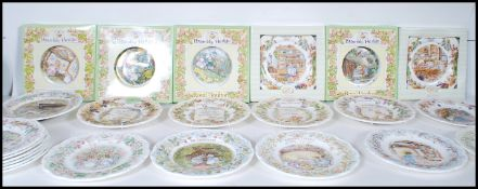 A group of 22 Royal Doulton Brambly Hedge ceramic collectors plates along with a wall clock to
