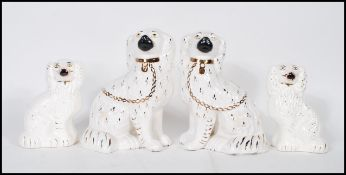 Two pairs of late 19th / early 20th century Victorian King Charles Spaniel ceramic Staffordshire