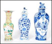 A group of three 19th Century Chinese vases / urns, one being famille jaune and verte having central