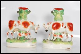 A pair of 19th Century VictorianStaffordshire flatback spill vases.Each having oval naturalistic