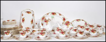An extensive Royal Albert Old Country Roses tea service / dinner service having a white ground