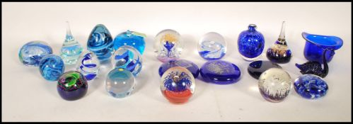 A collection of glass paper weights to include Caithness, Gozo glass, Selkirk, Pembrokeshire, London