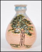 A vintage retro 20th Century West German Bay Keramic fat lava vase, the bulbous vase on a pink and