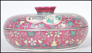 A early 20th Century 1920's Chinese lidded crudite having dark red enamelled ground with floral