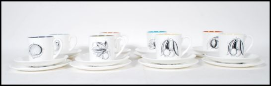 A retro Susie Cooper for Wedgwood coffee service in black fruit pattern to include eight coffee