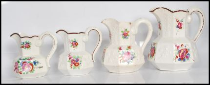A group of four 19th Century Staffordshire ceramic jugs, possibly mason's in the Hydra shape of