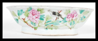 An early 20th Century Chinese porcelain bowl of scalloped form having hand painted decoration