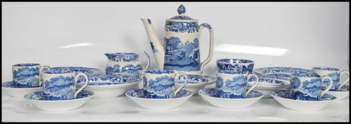 A mid 20th Century Copeland and Spode coffee services in the transfer printed Italian pattern