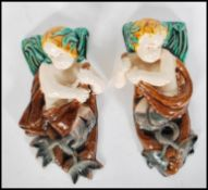 A pair of 19th Century Victorian figural majolica
