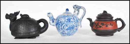 A group of three Chinese teapots dating from the e