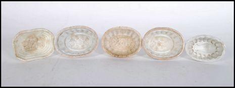 A group of five 19th Century ceramic miniature jel