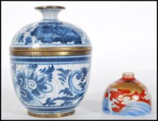 A Chinese hand painted blue and white crackle glaz