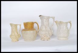 A group of four jugs to include a Doulton Lambeth