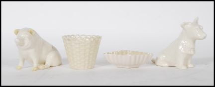 A collection of four Irish Belleek porcelain ceramics to include a Scottie Dog with green stamp to