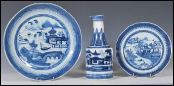 A Chinese 19th Century Canton blue and white mallet vase having a cylindrical body with a tapering