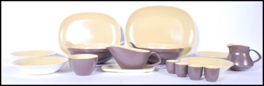 A vintage 20th Century part dinner service by Poole Pottery. The two tone colour service