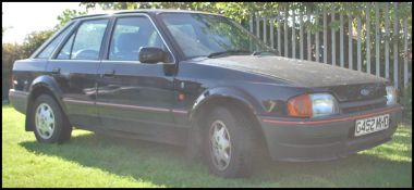A 1990 ' G' Registration Ford Escort 1597cc ( 1.6) Ghia 5dr in black with 22000 miles on the clock (