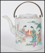 A 19th Century Chinese ceramic teapot of cylindrical form being hand painted with a domestic scene