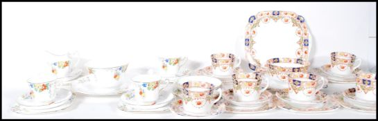 A set of 1930's Art Deco Sampson Smith Wetley China part tea service in a wisteria pattern